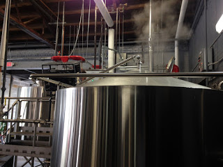 Steam being released from large brewery tank