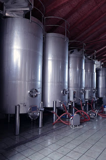 A row of stainless steel wine vats