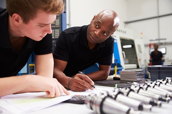 Engineer And Apprentice Planning CNC Machinery Project